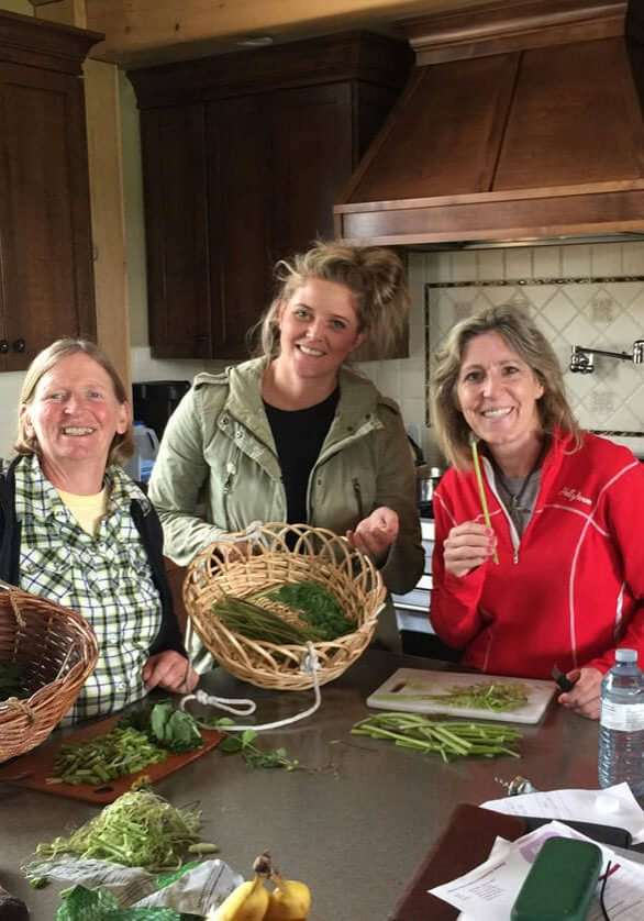 julie and chef brittany swanwild showing results from a wild food forage and edible wild at home outing